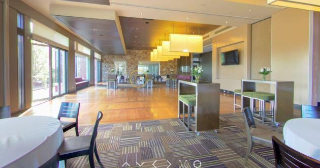 Grand Room with Panoramic Views of Rolling Green Fairways
