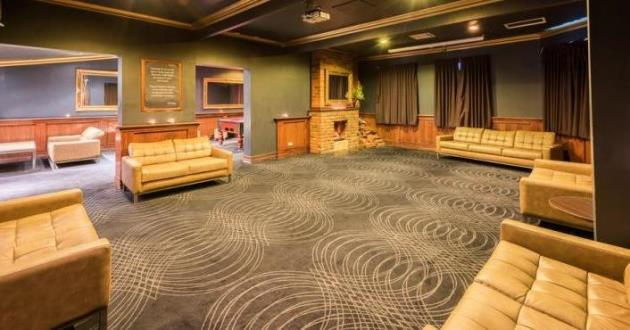 The Loft w/ Comfortable Lounge Setting and Boasting Couches